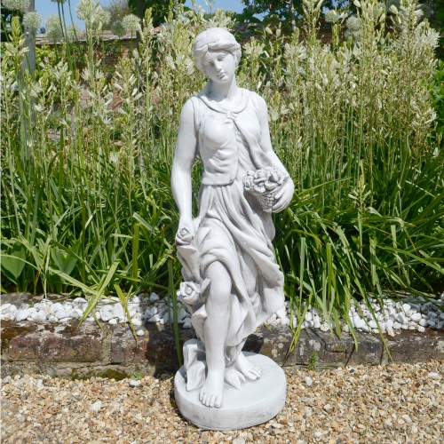 Susie in Spring garden statue
