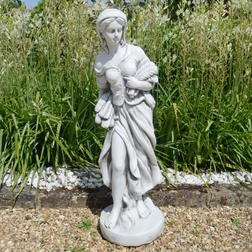 Annie in Autumn garden statue
