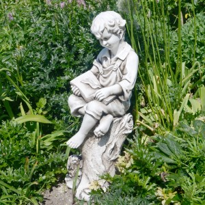 Matthew reading boy statue